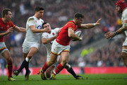 Gareth Davies of Wales is tackled by George Ford and Ben Youngs of England during the RBS Six Nations match between England and Wales at Twickenham Stadium on March 12, 2016 in London, England.