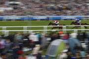 Paul Hanagan riding Imshivalla (L) win The Investec Wealth & Investment Stakes at Epsom Racecourse on June 3, 2016 in Epsom, England.