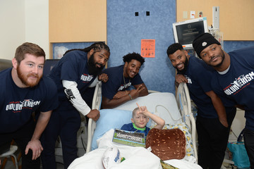 Eric Smith New England Patriots Players Surprise Patients At Boston Children's Hospital