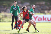 Jake Stringer of Essendon, tipped to be an inclusion for this weekend, is tackled by  Jake Long (L) during an Essendon Bombers AFL training session at The Hangar on July 24, 2018 in Melbourne, Australia.