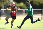 Jake Long of the Bombers and Adam Saad of the Bombers compete for the ball  during an Essendon Bombers AFL training session at The Hangar on August 1, 2018 in Melbourne, Australia.