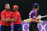 Jesse Ryder and Ravi Bopara of Essex celebrate the dismissal of Jonny Bairstow of Yorkshire during the Royal London One-Day Cup Quarter Final match between Essex and Yorkshire at The Essex County Ground on August 27, 2015 in Chelmsford, England.