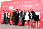 (L-R) Anne Consigny, Jon Kilik, Lolita Chammah, Jean-Claude Carriere, Benoit Delhomme, Vladimir Consigny, Mads Mikkelsen, Willem Dafoe, Louise Kugelberg, Julian Schnabel and Emmanuelle Seigner attend 'At Eternity's Gate' photocall during the 75th Venice Film Festival at Sala Casino on September 3, 2018 in Venice, Italy.