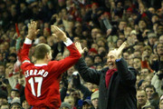 Steven Gerrard of Liverpool celebrates with manager Gerard Houllier after scoring the first goal during the UEFA Cup third round first leg match between Liverpool and Levski Sofia at Anfield on February 26, 2004 in Liverpool, England.