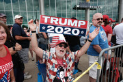 Donald Trump supporters gather outside of an arena in Manchester before a scheduled evening rally by Trump on August 15, 2019 in Manchester, New Hampshire. The Trump 2020 campaign is looking to flip the battleground state of New Hampshire with the use of a strong economy and appeals to his core voters on immigration and guns.