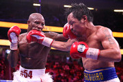 Yordenis Ugas (L) connects with a punch on Manny Pacquiao during their WBA welterweight title fight at T-Mobile Arena on August 21, 2021 in Las Vegas, Nevada. Ugas retained his title by unanimous decision.
