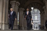 British Prime Minister Boris Johnson and Chancellor Rishi Sunak head to the weekly cabinet meeting at the British Foreign and Commonwealth Office on October 13, 2020 in London, England. The Prime Minister chairs first full meeting of the government's decision making unit after announcing their three-tier system of coronavirus measures to the nation yesterday evening.