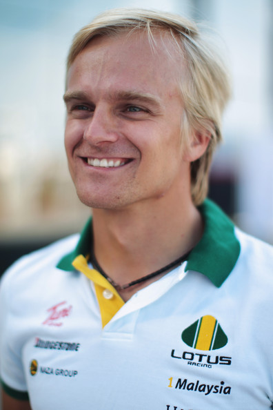 Heikki Kovalainen of Finland and Lotus walks in the pitlane following practice for the European Formula One Grand Prix at the Valencia Street Circuit on July 25, 2010, in Valencia, Spain.