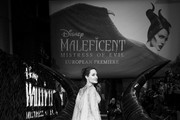 """Image has been converted to black and white) Angelina Jolie attends the European Premiere of Disney's """"Maleficent: Mistress of Evil"""" at Odeon IMAX Waterloo on October 09, 2019 in London, England."""