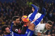Hugo Lloris and Kieran Trippier of Tottenham Hotspur foil Sean Morrison of Cardiff City during the Premier League match between Cardiff City and Tottenham Hotspur at Cardiff City Stadium on January 1, 2019 in Cardiff, United Kingdom.