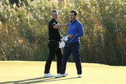 Mark Foster of England and Gonzalo Fernandez-Castano of Spain celebrate earning their tour cards during the final round of the European Tour Qualifying School Final Stage at Lumine Golf Club on November 16, 2017 in Tarragona, Spain.