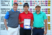 (L-R) Ulrich Van den Berg of South Africa, Daniel Im of the USA and Adrian Otaegui of Spain pose with the winners trophy after all finishing jointly on -18 under par during the final round of the European Tour Qualifying School Final at PGA Catalunya Resort on November 19, 2015 in Girona, Spain.