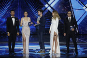 (L-R) Hosts Assi Azar, Lucy Ayoub, Duncan Laurence with the 2019 trophy, Bar Refaeli and Erez Tal on stage after the 64th annual Eurovision Song Contest held at Tel Aviv Fairgrounds on May 18, 2019 in Tel Aviv, Israel.