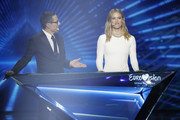Hosts Erez Tal and Bar Refaeli on stage after the 64th annual Eurovision Song Contest held at Tel Aviv Fairgrounds on May 18, 2019 in Tel Aviv, Israel.
