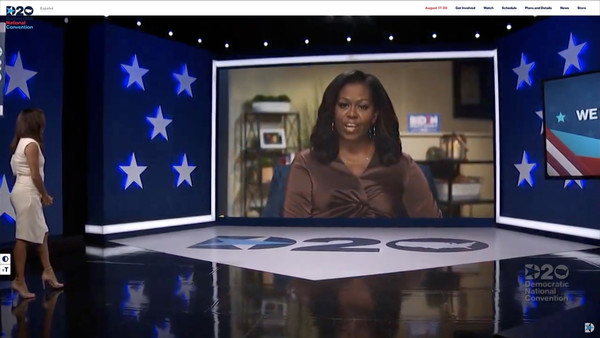 Democrats Hold Unprecedented Virtual Convention From Milwaukee [display device,media,newscaster,television,news,flat panel display,technology,newsreader,room,electronic device,display device,eva longoria,michelle obama,actress,dncc\u00e2,democrats hold unprecedented virtual convention,screenshot,television,milwaukee,convention,television,superman,display device,computer monitor,christopher reeve]