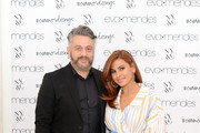 (L-R) SVP of Design at New York & Company Alejandro Blanco poses with Eva Mendes as she visits New York & Company Store on March 15, 2019 in Burbank, California.