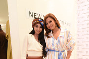 A shopper poses with Eva Mendes as she visits New York & Company Store on March 15, 2019 in Burbank, California.