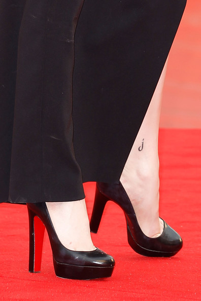 "Evan Rachel Wood Actress Evan Rachel Wood (tatoo detail) attends the ""Mildred Pierce"" premiere during the 68th Venice Film Festival at Palazzo del Cinema on September 2, 2011 in Venice, Italy."