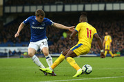 Wilfried Zaha of Crystal Palace is fouled by Seamus Coleman of Everton and the situation leads to a penalty given to Crystal Palace during the Premier League match between Everton FC and Crystal Palace at Goodison Park on October 21, 2018 in Liverpool, United Kingdom.