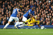Kurt Zouma of Everton tackles Wilfried Zaha of Crystal Palace during the Premier League match between Everton FC and Crystal Palace at Goodison Park on October 21, 2018 in Liverpool, United Kingdom.