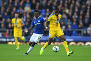 Idrissa Gueye of Everton and Wilfried Zaha of Crystal Palace battle for possession during the Premier League match between Everton FC and Crystal Palace at Goodison Park on October 21, 2018 in Liverpool, United Kingdom.