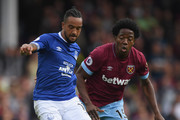 Everton player Theo Walcott (l) is challenged by Carlos Sanchez of West Ham during the Premier League match between Everton FC and West Ham United at Goodison Park on September 16, 2018 in Liverpool, United Kingdom.