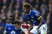 Joey Barton of Burnley and Mason Holgate of Everton battle for possession during the Premier League match between Everton and Burnley at Goodison Park on April 15, 2017 in Liverpool, England.