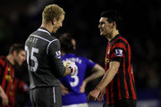 Joe Hart (L) and Gareth Barry of Manchester City react as play is halted after a man handcuffed himself to the goalposts during the Barclays Premier League match between Everton and Manchester City at Goodison Park on January 31, 2012 in Liverpool, England.