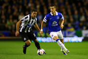 Kevin Mirallas of Everton in action against Hatem Ben Arfa of Newcastle during the Barclays Premier League match between Everton and Newcastle United at Goodison Park on September 30, 2013 in Liverpool, England.