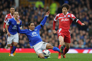 Steven Pienaar of Everton challenges Ji-Sung Park of Queens Park Rangers during the Barclays Premier League match between Everton and Queens Park Rangers at Goodison Park on April 13, 2013 in Liverpool, England.