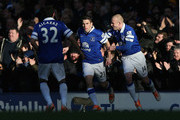 Seamus Coleman of Everton celebrates scoring the opening goal with team-mate Steven Naismith (r) during the Barclays Premier League match between Everton and Southampton at Goodison Park on December 29, 2013 in Liverpool, England.