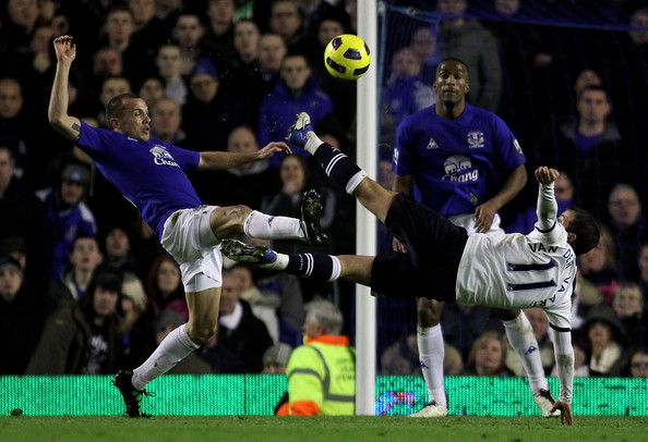 Rafael Van der Vaart of Tottenham Hotspur competes with John Heitinga of Everton during the Barclays Premier League match between Everton and Tottenham Hotspur at Goodison Park on January 5, 2011 in Liverpool, England.