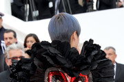 """Singer Li Yuchun, back detail, attends the screening of """"Everybody Knows (Todos Lo Saben)"""" and the opening gala during the 71st annual Cannes Film Festival at Palais des Festivals on May 8, 2018 in Cannes, France."""