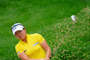 Hyun - Ji Kim of South Korea plays her bunker shot on the third hole during the second round of the 2010 Evian Masters on July 22, 2010 in Evian, France.