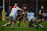 Alec Hepburn of Exeter Chiefs is tackled by Dan Cole and Michael Fitzgerald of Leicester Tigers during the Aviva Premiership match between Exeter Chiefs and Leicester Tigers at Sandy Park on December 31, 2017 in Exeter, England.