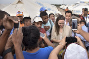 United Nations High Commissioner for Refugees (UNCHR) Special Envoy Angelina Jolie greets children during her visit to a refugee camp in the border between Colombia and Venezuela on June 8, 2019 in Maicao, Colombia. UN and International Organization for Migration (IOM) announced yesterday that 4 million of Venezuelans have left their country since 2015 due to the social, political and economic crisis, which means they are of the single largest population groups displaced from their country globally. The camp in Maicao has 60 tents  which can accommodate up to 350 people. Due to high demand, UNHCR is considering an expansion to give shelter to 1,400 people. Colombia it the top host of Venezuelan migrants and refugees, accounting 1.3 million.