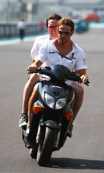 Jenson Button of Great Britain and Brawn GP drives the circuit on his scooter during previews to the Abu Dhabi Formula One Grand Prix at the Yas Marina Circuit on October 29, 2009 in Abu Dhabi, United Arab Emirates.
