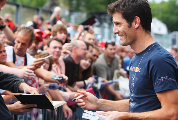 Mark Webber of Australia and Red Bull Racing signs autographs for fans during previews to the Belgian Grand Prix at the Circuit of Spa Francorchamps on August 27, 2009 in Spa Francorchamps, Belgium.