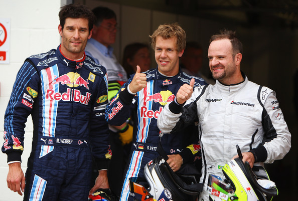 Pole sitter Sebastian Vettel (C) of Germany and Red Bull Racing celebrates with second placed Rubens Barrichello (R) of Brazil and Brawn GP and third placed Mark Webber (L) of Australia and Red Bull Racing following qualifying for the British Formula One Grand Prix at Silverstone on June 20, 2009 in Northampton, England.