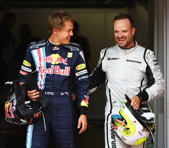 Pole sitter Sebastian Vettel (L) of Germany and Red Bull Racing celebrates with second placed Rubens Barrichello (R) of Brazil and Brawn GP following qualifying for the British Formula One Grand Prix at Silverstone on June 20, 2009 in Northampton, England.