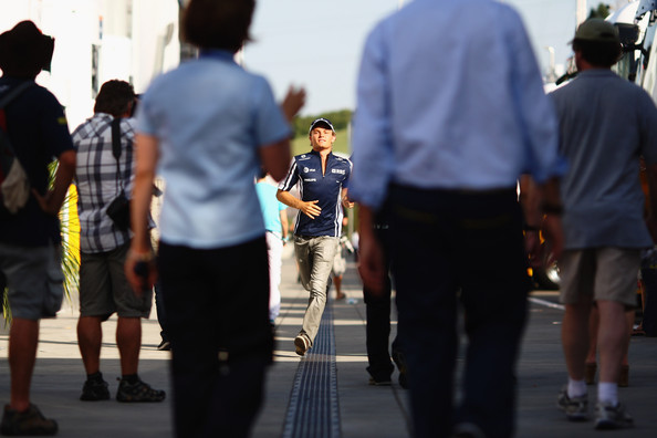 Nico Rosberg of Germany and Williams runs down the paddock during previews to the the Hungarian Formula One Grand Prix at the Hungaroring on July 23, 2009 in Budapest, Hungary.