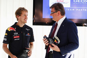 Sebastian Vettel (L) of Germany and Red Bull Racing is seen with GEOX Chairman Mario Moretti Polegato (R) at a press conference during previews to the Italian Formula One Grand Prix at the Autodromo Nazionale di Monza on September 8, 2011 in Monza, Italy.