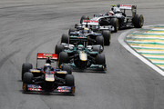 Jaime Alguersuari of Spain and Scuderia Toro Rosso leads a group of cars during the Brazilian Formula One Grand Prix at the Autodromo Jose Carlos Pace on November 27, 2011 in Sao Paulo, Brazil.