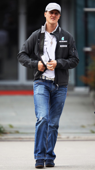 Michael Schumacher of Germany and Mercedes GP walks in the paddock before the Chinese Formula One Grand Prix at the Shanghai International Circuit on April 18, 2010 in Shanghai, China.