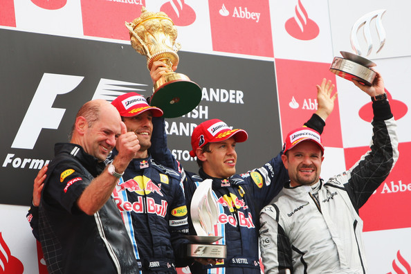 (L-R) Red Bull Racing designer Adrian Newey, second placed Mark Webber of Australia and Red Bull Racing, race winner Sebastian Vettel of Germany and Red Bull Racing and third placed Rubens Barrichello of Brazil and Brawn GP celebrate on the podium following the British Formula One Grand Prix at Silverstone on June 21, 2009 in Northampton, England.