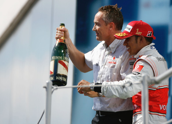 Lewis Hamilton of Great Britain and McLaren Mercedes celebrates on the podium with his Team Principal Martin Whitmarsh after winning the Hungarian Formula One Grand Prix at the Hungaroring on July 26, 2009 in Budapest, Hungary.