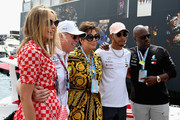 Lewis Hamilton of Great Britain and Mercedes GP poses for a photo with Kris Jenner, Corey Gamble and friends in the Paddock before the Monaco Formula One Grand Prix at Circuit de Monaco on May 27, 2018 in Monte-Carlo, Monaco.