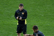 Neymar JR. (r) of FC Barcelona performs as his teammate Lionel Messi (L) looks him during the training session the day before the UEFA Champions League Quarter-final match between Atletico de Madrid and FC Barcelona at Vicente Calderon Stadium on April 8, 2014 in Madrid, Spain.