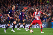 Koke of Atletico de Madrid plays the ball under pressure from Ivan Rakitic of FC Barcelona during the La Liga match between FC Barcelona and  Club Atletico de Madrid at Camp Nou on April 06, 2019 in Barcelona, Spain.