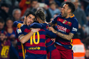 Luis Suarez (L) of FC Barcelona celebrates with his teammates Lionel Messi (2nd L), Neymar Santos Jr (2nd R)) and Dani Alves (R) after scoring his team's first goal during the Copa del Rey Quarter Final Second Leg between FC Barcelona and Athletic Club at Camp Nou stadium on January 27, 2016 in Barcelona, Spain.